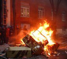 Violence erupts during Paris protest against Macron's security law