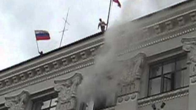 Smoke Emanates From Captured Administration Building in Luhansk