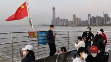 Key China coronavirus hospital says HIV drug beneficial to patients