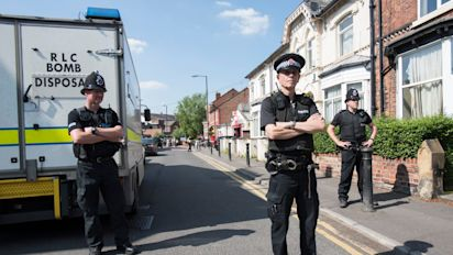 Manchester bombing: eight men arrested in dramatic armed raids as police race against the clock