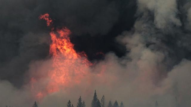 Firefighters try to save three small Calif. towns