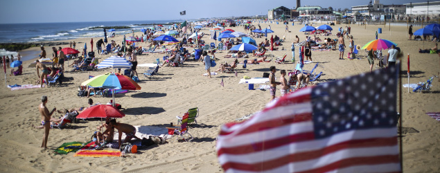 Americans are spending more on vacation this summer — but there's a catch (Getty Images)