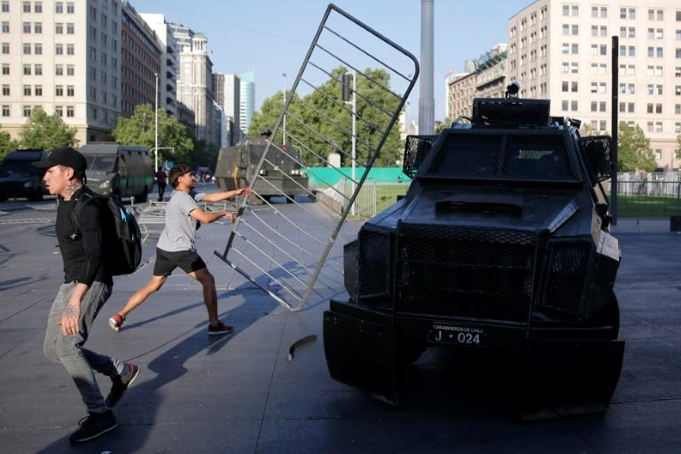 Chile paralysed after three die in violent protest