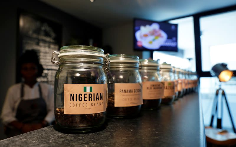 A jar of Nigerian coffee beans sits at the front of a row of coffee bean jars at Mai Shayi cafe in Victoria Island, Lagos