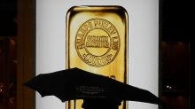 Gold prices fall as dollar gains, stocks rebound