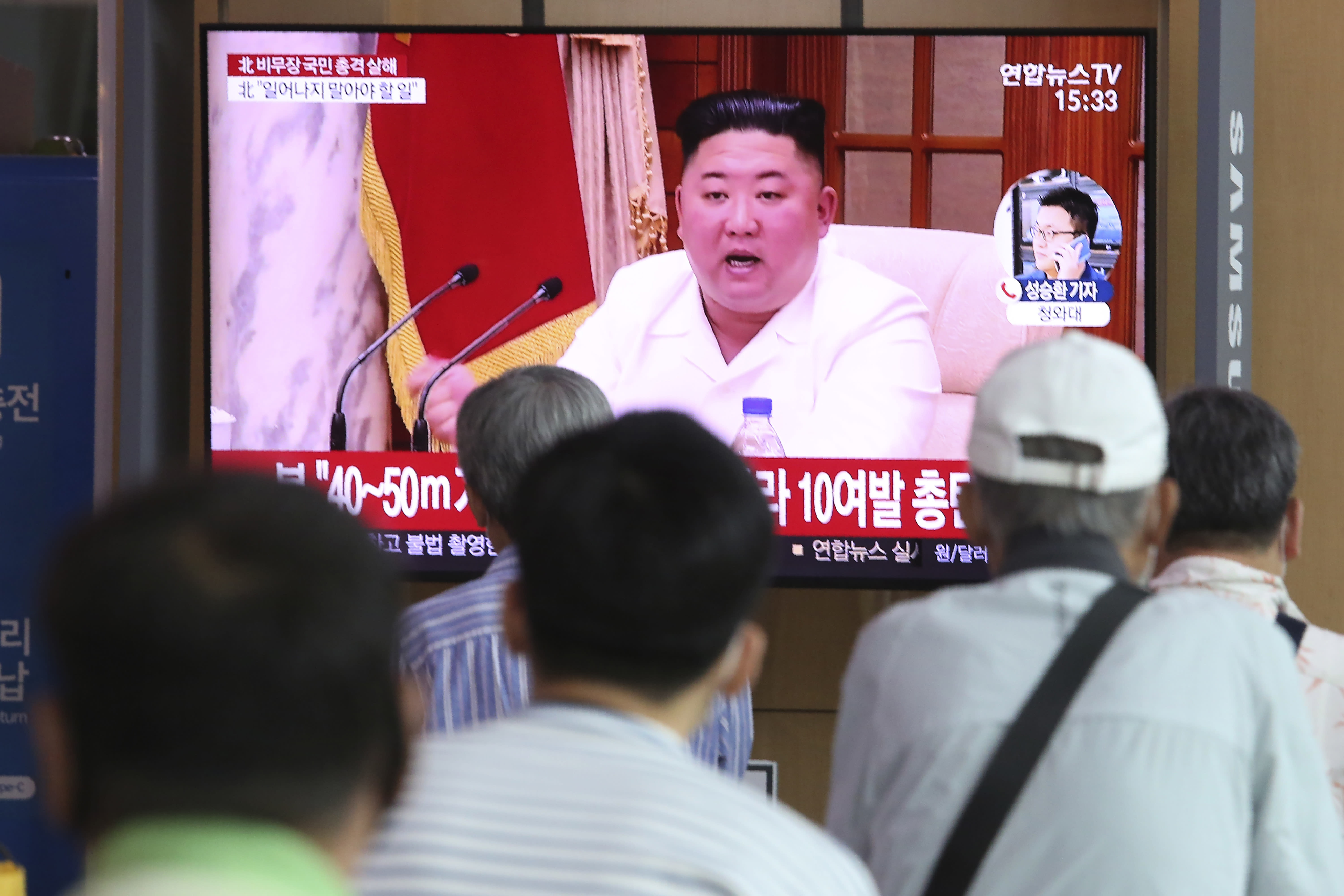 """People watch a screen showing a file image of North Korean leader Kim Jong Un during a news program at the Seoul Railway Station in Seoul, South Korea, Friday, Sept. 25, 2020. Kim apologized Friday over the killing of a South Korea official near the rivals' disputed sea boundary, saying he's """"very sorry"""" about the """"unexpected"""" and """"unfortunate"""" incident, South Korean officials said Friday. (AP Photo/Ahn Young-joon)"""