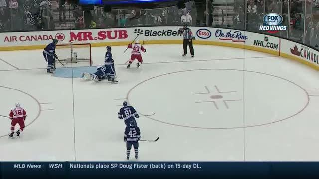 Helm controls puck and scores on his backhand
