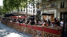 Outdoor seating only: Parisian cafes eek out space along sidewalks