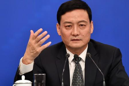 FILE PHOTO: Xiao Yaqing, chairman of the State-owned Assets Supervision and Administration Commission (SASAC) attends a news conference in Beijing