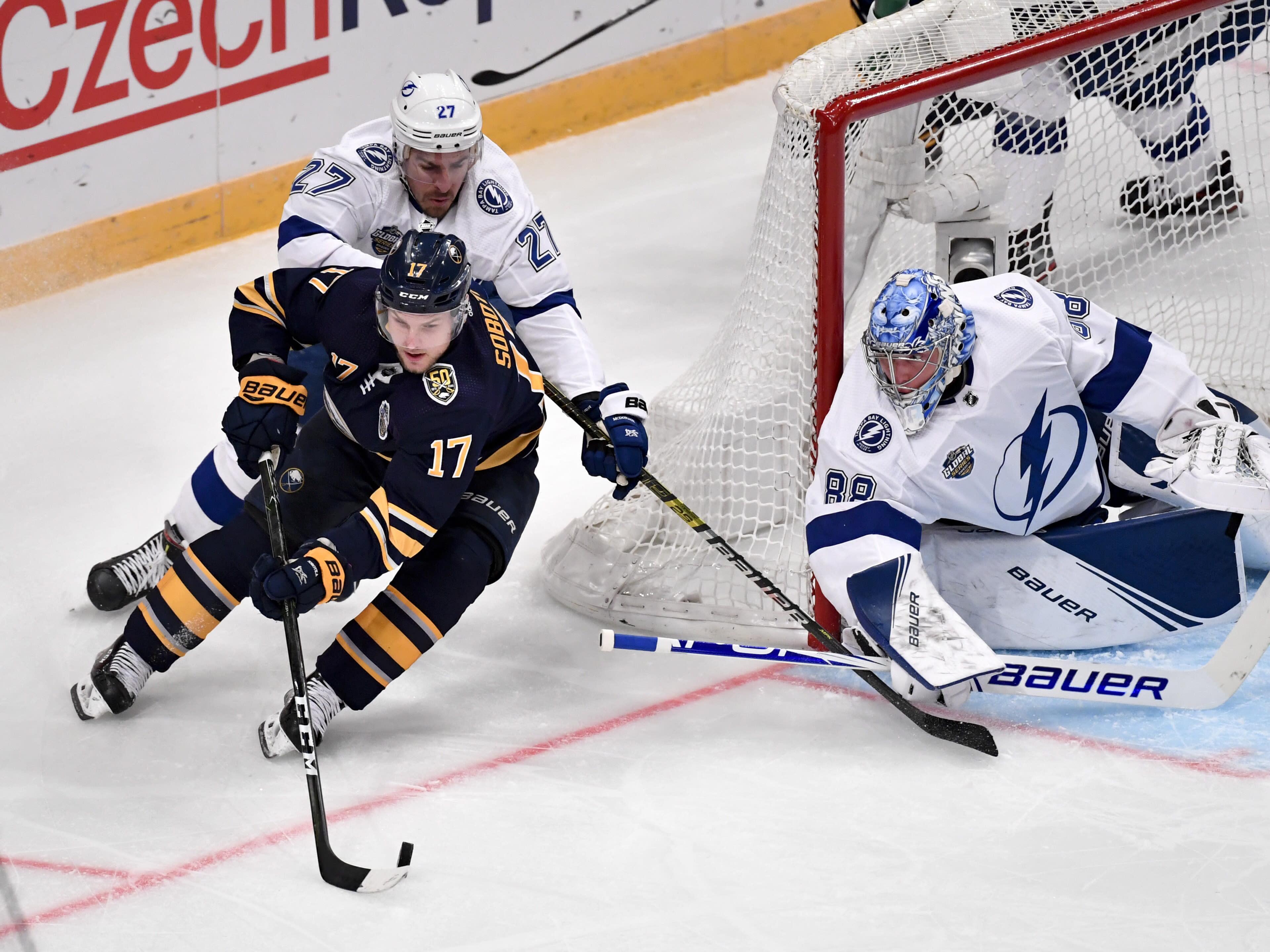Buffalo Sabres' Vladimir Sobotka (17) works the puck as Tampa Bay Lightning's Ryan McDonagh (27) and goalie Andrei Vasilevskiy defend during an NHL hockey game in Globen Arena, Stockholm Sweden. Friday. Nov. 8, 2019. (Anders Wiklund/TT via AP)