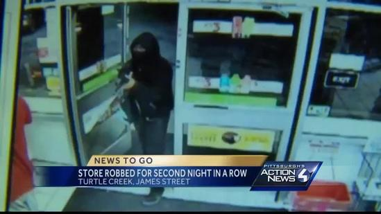 Surveillance video: Man with rifle robs Turtle Creek store
