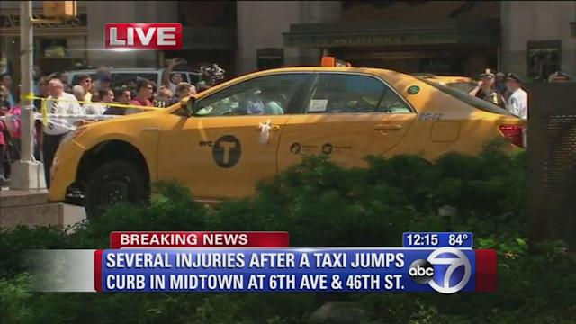 Woman struck by cab in midtown