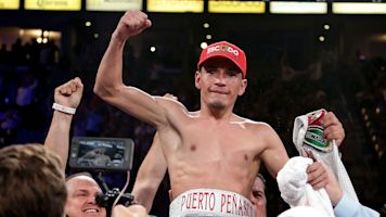 Estrada too much for Beamon in 9th-round TKO