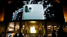 StockBeat: Apple in Crosshairs on iPhone 5G Debate