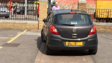 Amusing video shows driver trying to squeeze car through very narrow opening