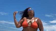 Lizzo writes tongue-in-cheek caption for latest bikini pic: 'Roll model'