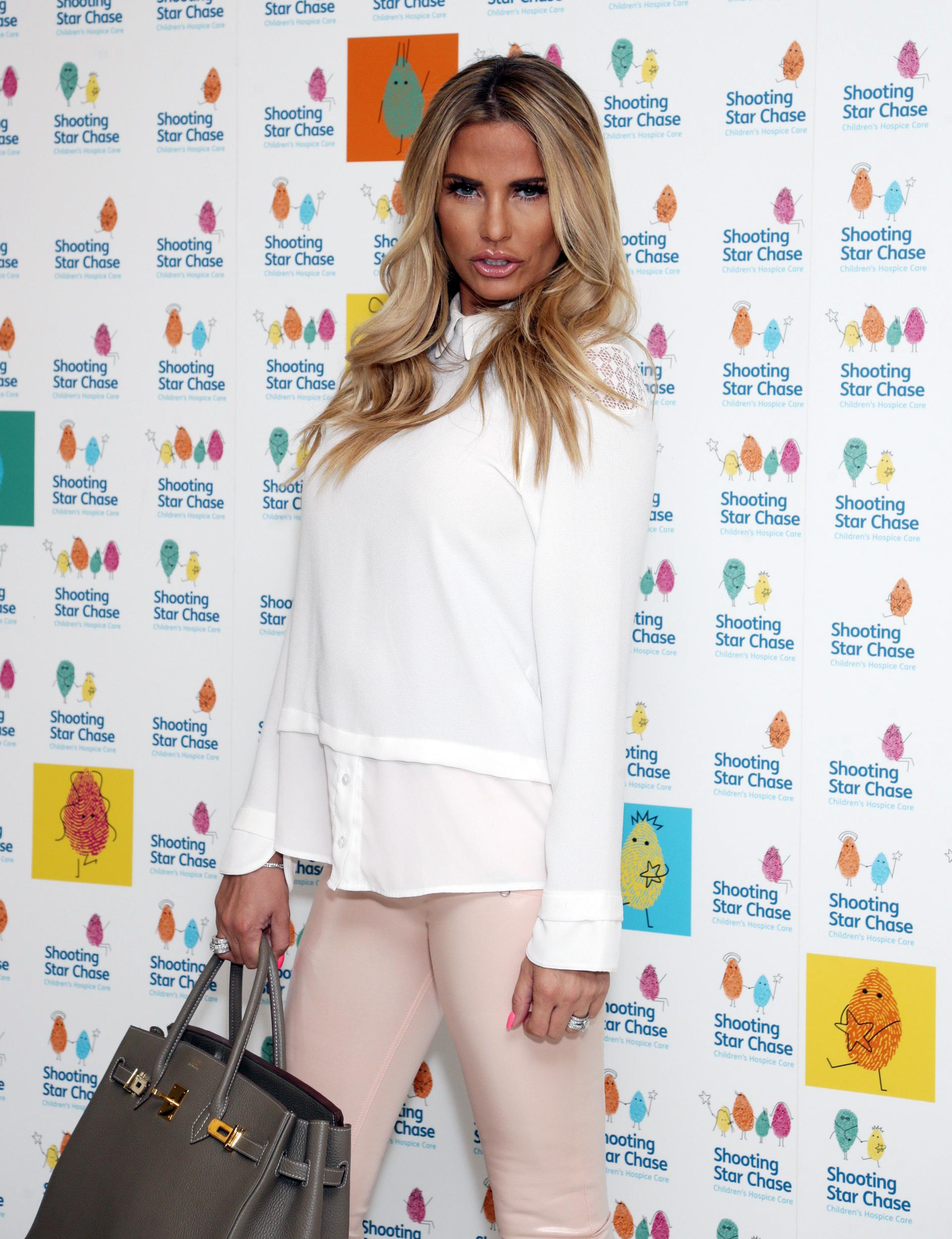 Katie Price attending the Shooting Star Chase childrenâs hospice charity tea party at The Dorchester in central London.