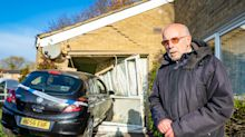 Pensioner saved by trip to the toilet as car smashes through living room