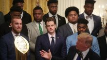 'They're trying to impeach the son of a b****': Trump jokes with football team ahead of Senate trial