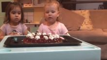 Little girls gobble up dessert right after their mums ask them to wait