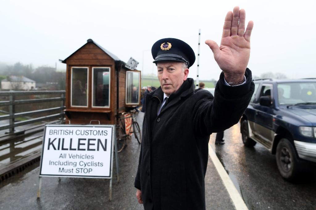 Demonstrators dressed as custom officials set up a mock customs checkpoint at the border crossing in Killeen, Northern Ireland near Dundalk to protest against the potential introduction of border checks post-Brexit (AFP Photo/Paul FAITH)