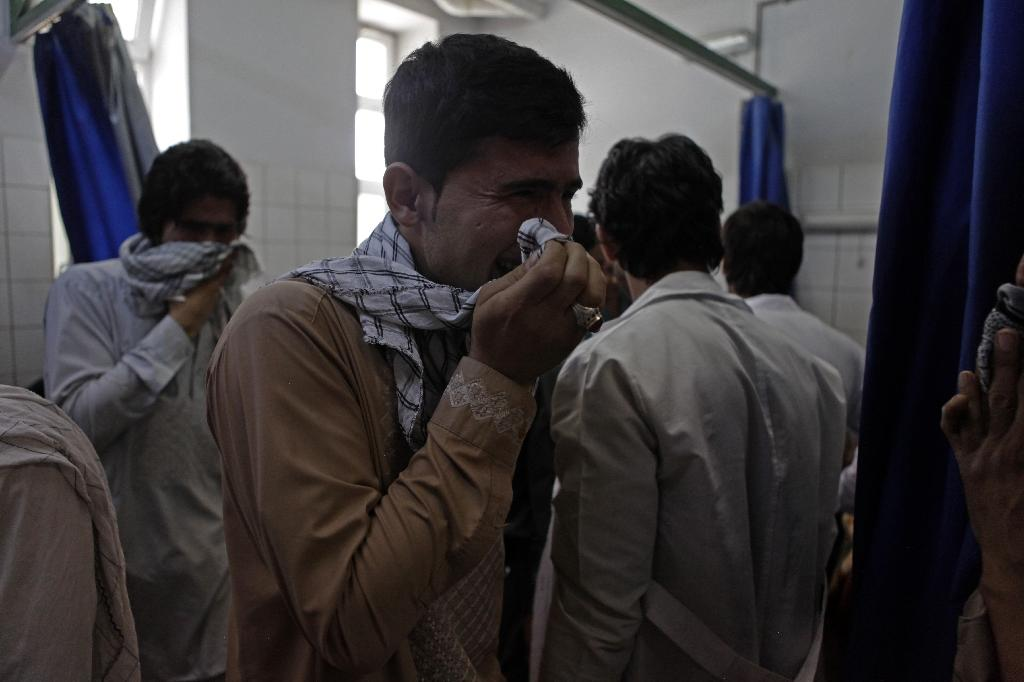 An Afghan relative cries after seeing the body of his brother, a slain aid worker, at a hospital in Mazar-i-Sharif on June 2, 2015 (AFP Photo/Bashir Dawodi)