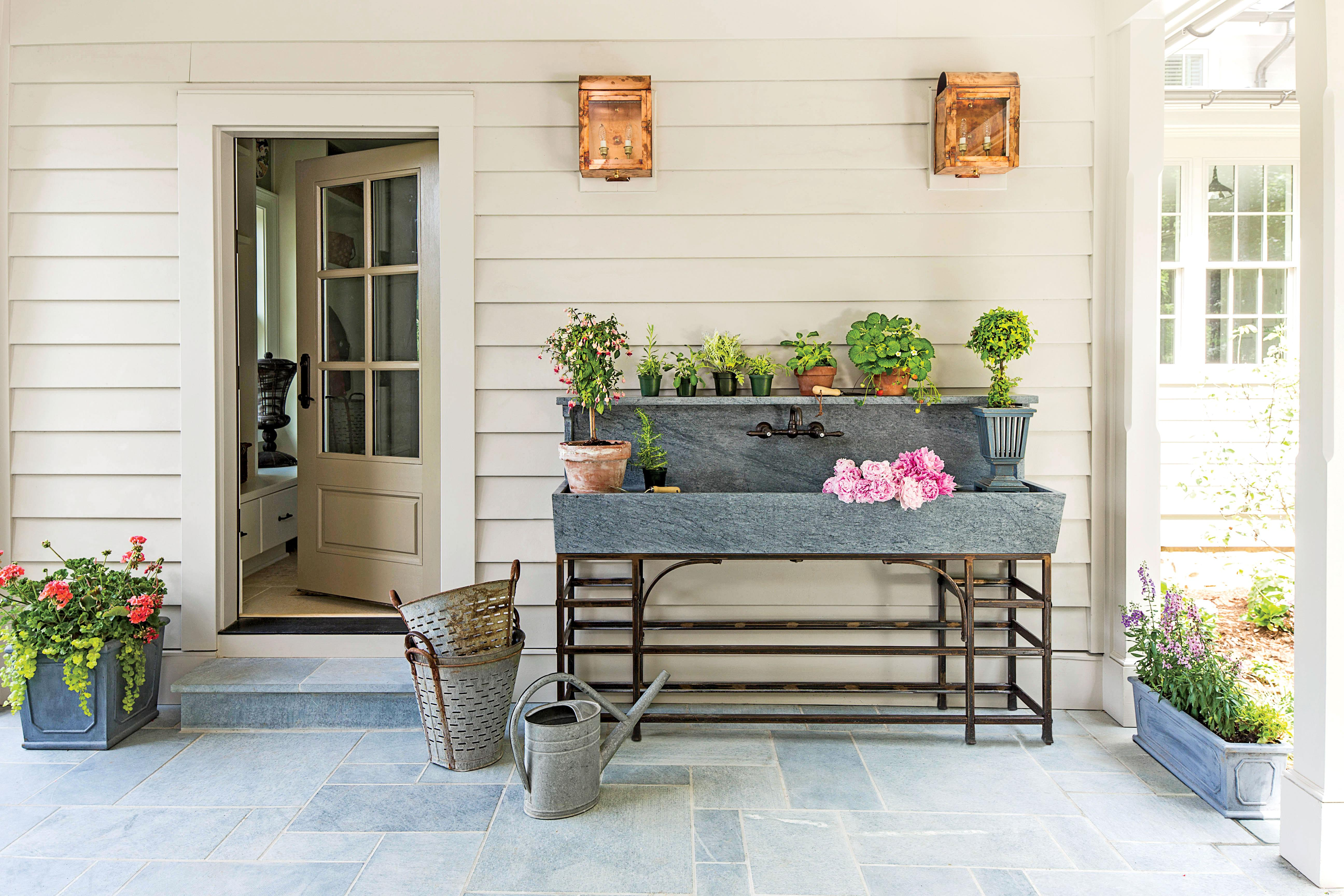 <p>Think outside the box. This small patio is used as a beautiful utility space thanks to a stunning galvanized sink.</p>