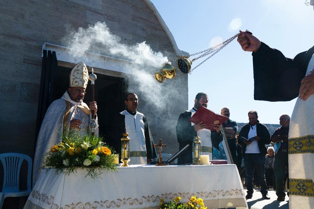 Maronite Archbishop of Cyprus Joseph Soueif leads a mass in the village of Kormakitis, once the hub of Cyprus's Sanna-speaking minority (AFP Photo/Iakovos Hatzistavrou)