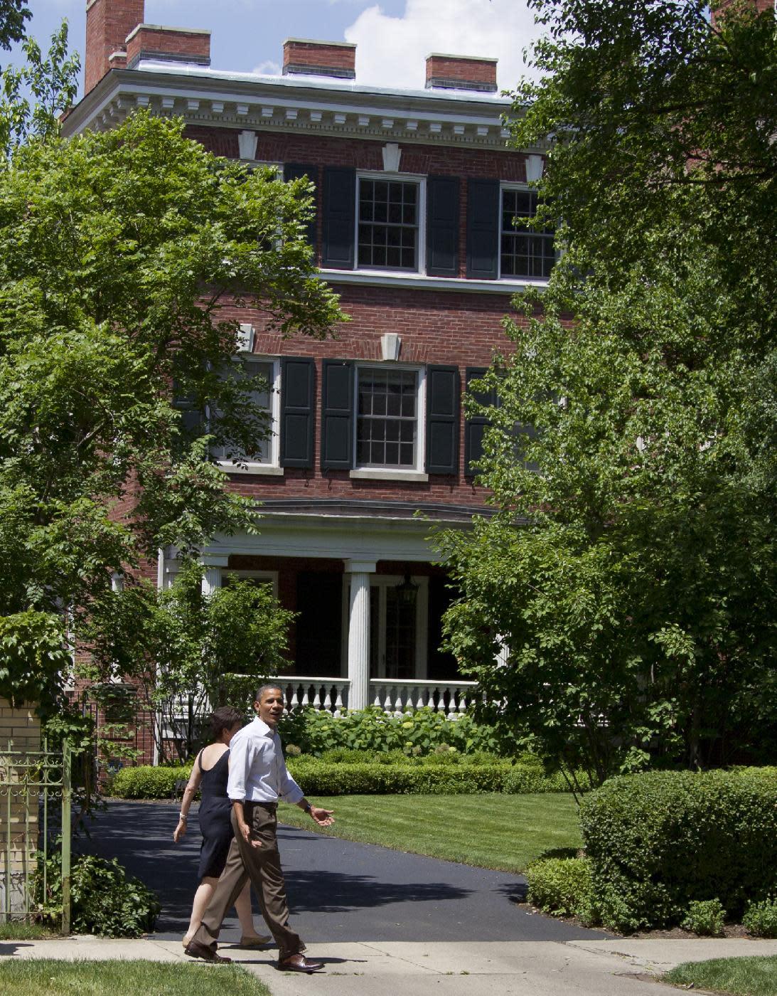 President Barack Obama walks through his Hyde Park neighborhood with senior advisor Valerie Jarrett to his friend Marty Nesbitt's home, Saturday, June 2, 2012, in Chicago. (AP Photo/Carolyn Kaster)