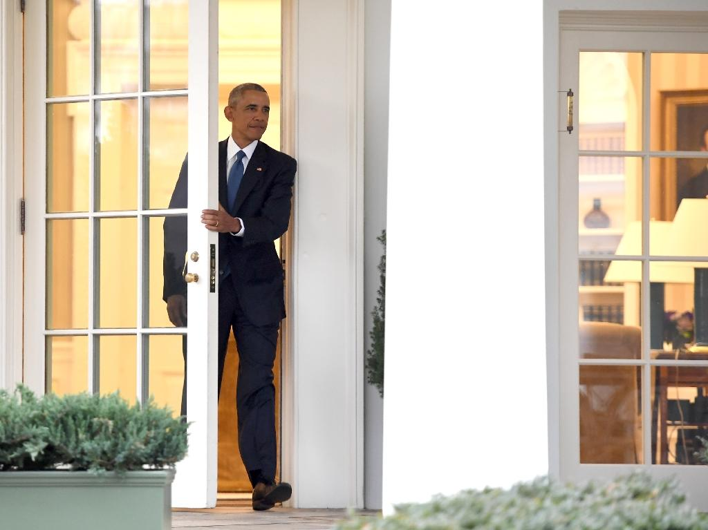 US President Barack Obama departs the Oval Office for the last time as president, at the White House on January 20, 2017