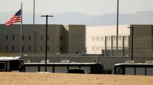Lawyers, workers question putting immigration detainees in U.S. prisons