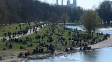 Merkel's govt agrees law on curfews, tougher virus curbs