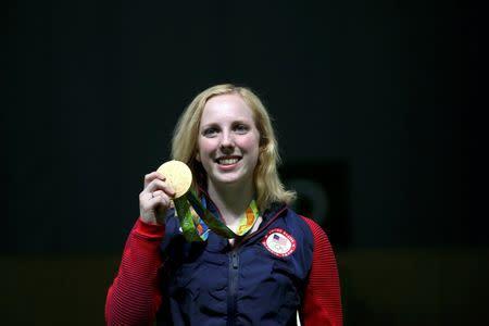 2016 Rio Olympics - Shooting - Final - Women's 10m Air Rifle Finals - Olympic Shooting Centre - Rio de Janeiro, Brazil - 06/08/2016. Virginia Thrasher (USA) of USA poses with her gold medal. REUTERS/Edgard Garrido
