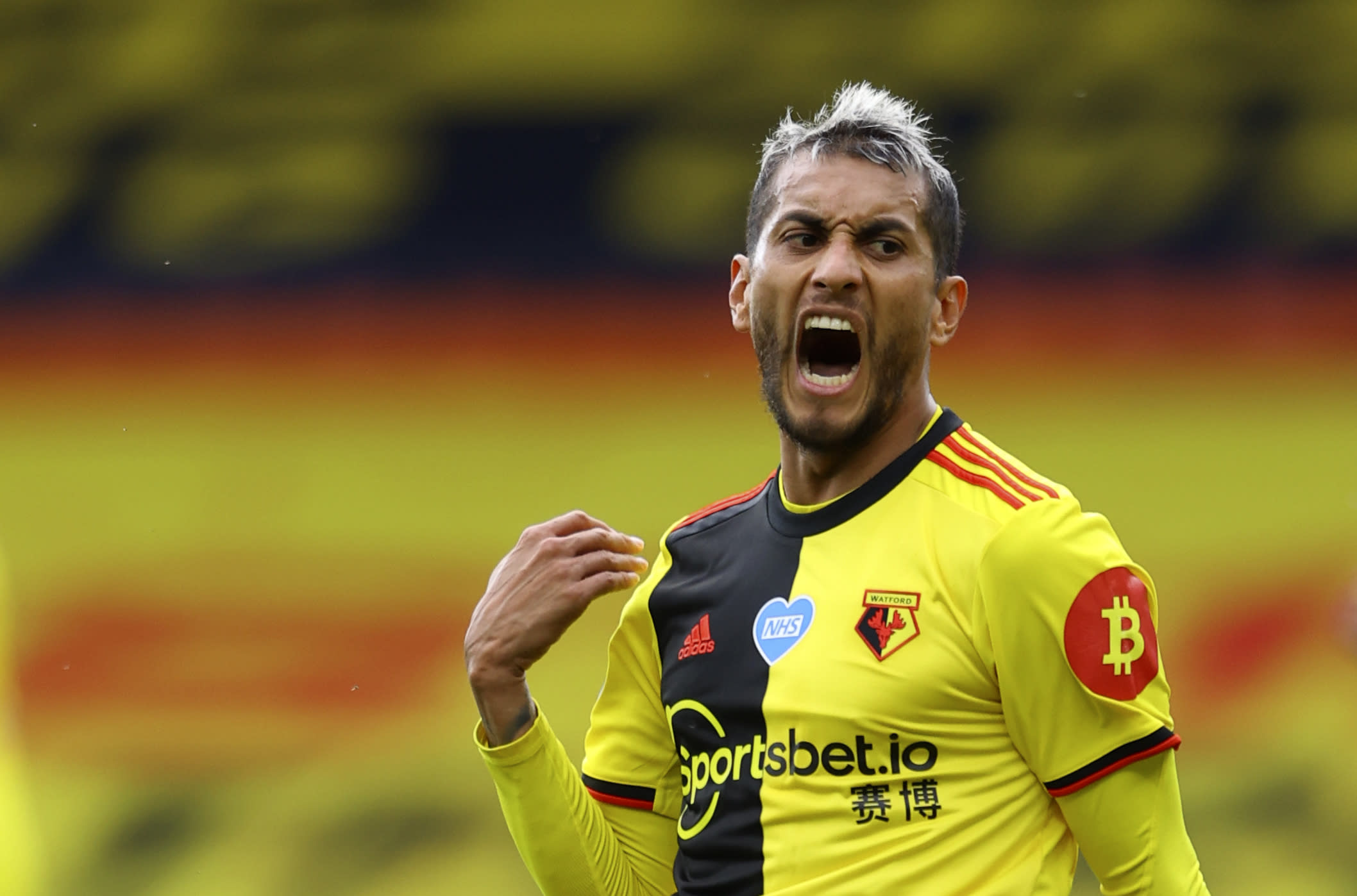 Watford's Roberto Pereyra reacts during the English Premier League soccer match between Watford and Manchester City at the Vicarage Road Stadium in Watford, England, Tuesday, July 21, 2020. (Richard Heathcote/Pool via AP)