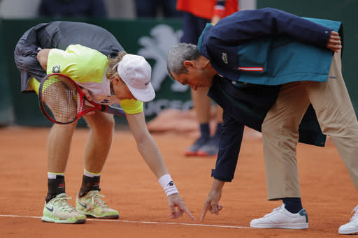 Canada's Denis Shapovalov argues with the umpire over a line call in the second round match of the French Open tennis tournament against Spain's Roberto Carballes Baena at the Roland Garros stadium in Paris, France, Thursday, Oct. 1, 2020. (AP Photo/Christophe Ena)