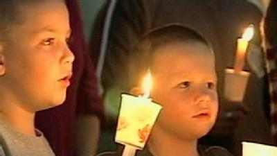 Candlelight Vigil Held For Wounded Policeman