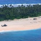 Giant SOS on Pacific isle leads to rescue of three stranded sailors