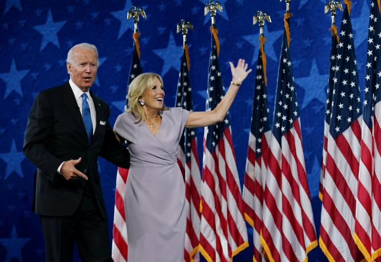 Democratic presidential nominee Joe Biden and his wife, Jill Biden, on stage at the Chase Center in Wilmington, Delaware, at the conclusion of the Democratic National Convention