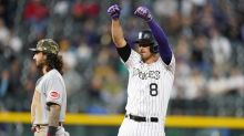 Hampson homers, triples as Rockies beat Reds 9-6