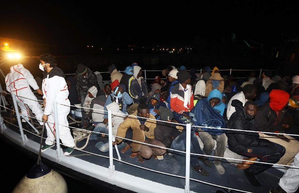 Illegal migrants from Arab and African countries arrive at a naval base in the capital Tripoli after being rescued off the coast of Zuwara