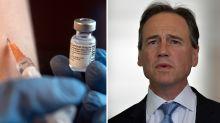 Australia will still roll out Covid vaccine despite 13 deaths