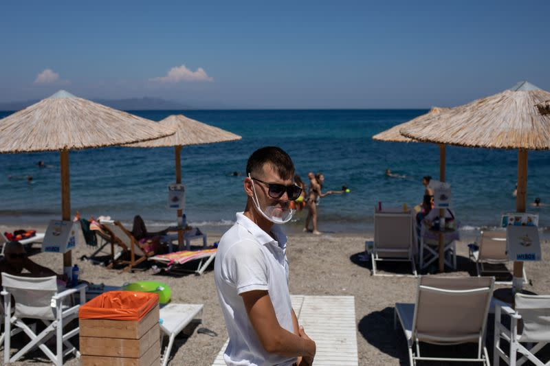 As tourists trickle back to resorts, Greeks have modest expectations