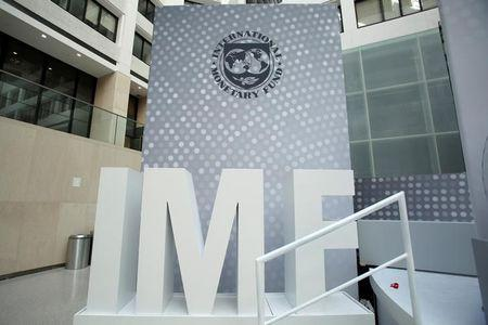 International Monetary Fund logo is seen inside the headquarters at the end of the IMF/World Bank annual meetings