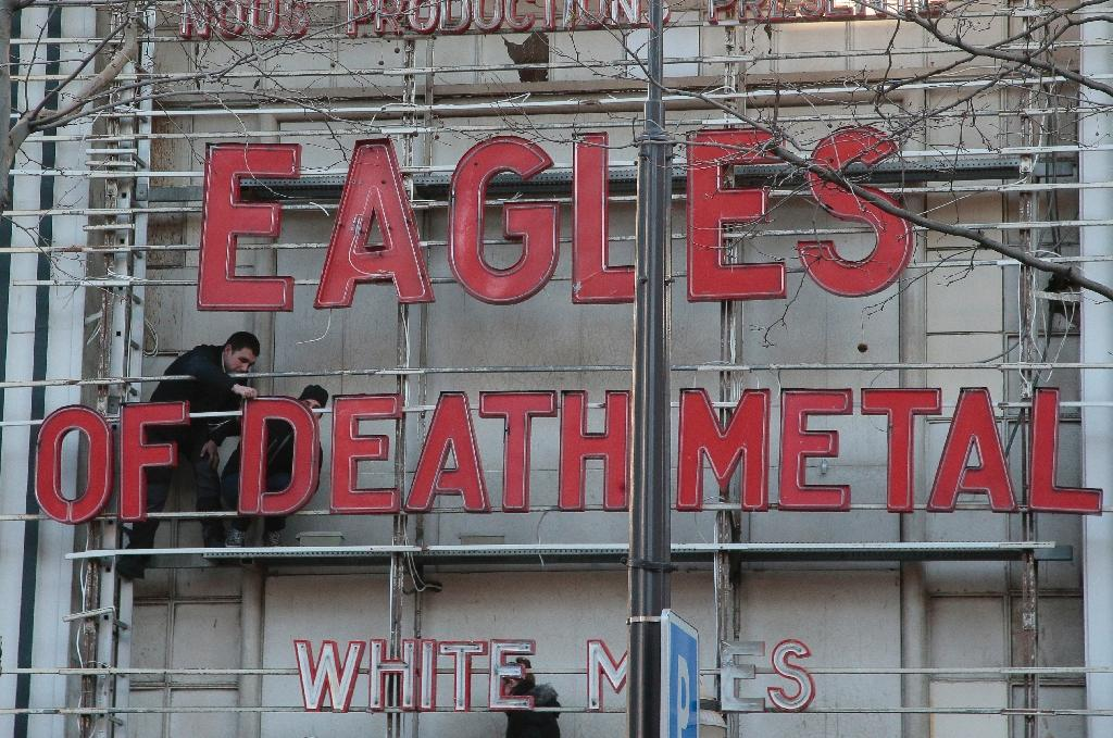 Employees at the Olympia concert hall in Paris set up lettering for the Eagles of Death Metal concert, on February 16, 2016 (AFP Photo/Jacques Demarthon)