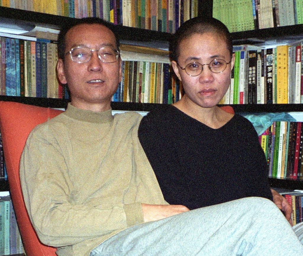 China has faced international pressure to let Liu Xiaobo (L) travel abroad to get treatment since he was transferred from prison to a hospital in June after he was diagnosed with terminal liver cancer
