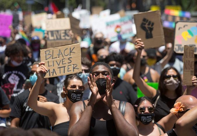 People take part in an All Black Lives Matter march, organized by Black LGBTQ+ leaders, in the aftermath of the death in Minneapolis police custody of George Floyd, in Hollywood, Los Angeles, California, U.S., June 14, 2020. REUTERS/Ringo Chiu