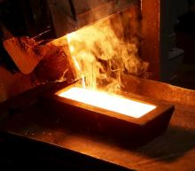 Gold prices slip on rising dollar and equities