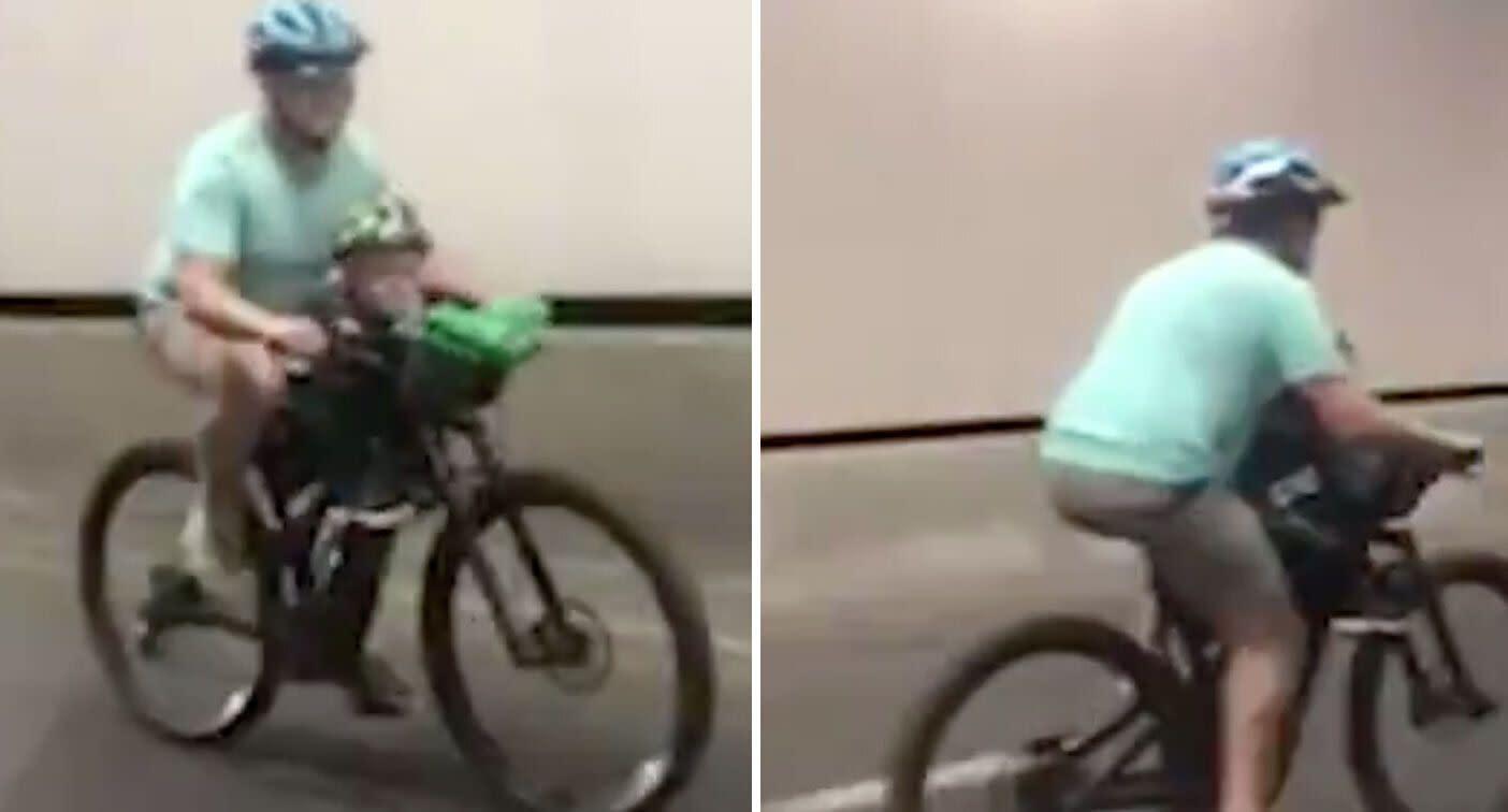Child clings to handlebars as man rides bike through tunnel