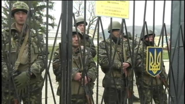 Pressure Mounts as Russian Troops Take Control of Crimea