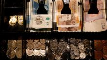 Euro slips as ECB ends bond purchases, pound firm